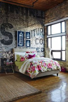 Beautiful industrial style bedroom with brick walls and floral bedding