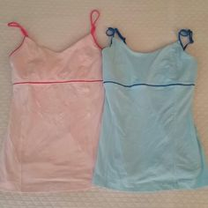 Lululemon Size 4 bundle of 2 tops built-in bra EUC In excellent used condition. one pink with hot pink details, the other light blue with blue details. Built-in bra, no cups, no tag, dot shows are 4. Very cute colors! No trades. lululemon athletica Tops