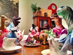 OH my heck, this tea party from the Dinovember family is the BEST. EVER. Look at their little DRESSES! #dinovember #trexinadress