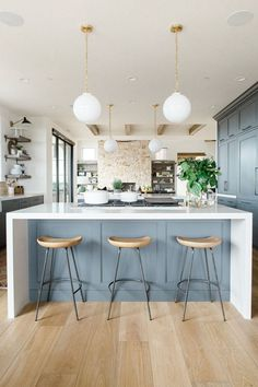 Pretty symmetry in this open kitchen.