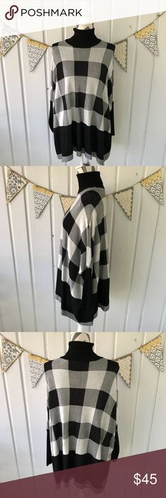 """Joseph A. Sweater Knit Buffalo Check Poncho This is a super cute sweater poncho by Joseph A. It has a fun black and white buffalo check design. It would layer perfectly over skinny jeans or leggings with boots. It is very oversized. I am a size Large and this small fits me. It measures approximately 32"""" across. Please note that there are some dark threads, mixed in with the light threads, throughout (see close up pic). Joseph A. Sweaters Shrugs & Ponchos"""