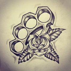 cracked skull with brass knuckles tattoo - Google Search