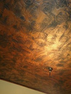 Oh, just look at this cool copper ceiling!  Not tiles, it's PAINT from Behr Paints.  The whole thing took five hours, including a base coat of green and then brushing on the copper over the base.  Gorgeous.