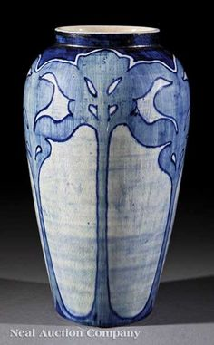 Newcomb College Art Pottery High Glaze Vase, 1902, decorated by Marie de Hoa LeBlanc with a pattern of stylized foliage in underglaze blue