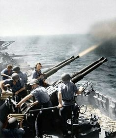40mm guns firing aboard USS Hornet, February 1945.