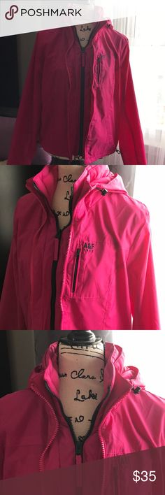 Abercrombie &Fitch Windbreaker Abercrombie & Fitch Pink Windbreaker. Women's size Large. Perfect for the rainy days. Jacket was purchased at a local A&F outlet hence the black streak across the logo. It was said to be irregular but there it absolutely nothing wrong with the jacket. Features include double zipper(fully functional) , three pockets, straps to tighten the sides of the jacket on bottom hem. Light layer of fleece around the neckline. I don't get to wear it enough. Good used…