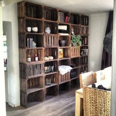 Wooden crate storage--love the floor to ceiling storage, would be great for a craft room!