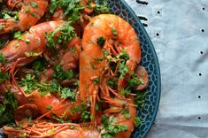 A recipe for whole shrimp braised in a spicy chorizo-infused broth.
