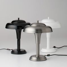 """Schoolhouse Electric & Supply Co """"Graduate"""" desk / table lamp - I love the stealth minimalism of the white powder coated one (more if it had a white cable, though!), and also the deco meets industrial feel of the steel one..."""