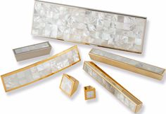 Jewellery for your furniture Polished gold and nickel handles with mother-of-pearl inlay