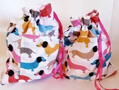 All colours but mainly pastels Lovely little drawstring bag to keep your dog treats in when out and about. Measures approx x Fully lined with pink spot All have a little pocket on the front Small clip to attach to your belt, pocket egg. Dog Treat Bag, Pet Bag, Treat Bags, Dachshunds, Dog Accessories, Dog Treats, Your Dog, Diaper Bag, Trending Outfits