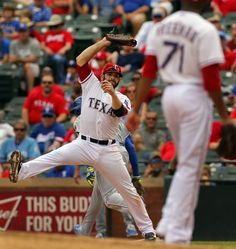 Texas Rangers first baseman Mitch Moreland (18) has to reach high to get Kansas City Royals batter Paulo Orlando (16) to end the top of the seventh inning at Globe Life Park in Arlington, Texas, Thursday, May 14, 2015. The Rangers lost 6-3. (Tom Fox/The Dallas Morning News)