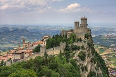 """The Guaita is a beautiful tower in San Marino. Also called """"Rocca"""" or """"The First Tower"""", it is one of the three towers located above the city of San Marino and it was built in the century by the first inhabitants of Mount Titano. Italy Vacation, Italy Travel, San Marino Italy, Saint Marin, Bósnia E Herzegovina, Republic Of San Marino, Italy Holidays, Destination Voyage, Visit Italy"""