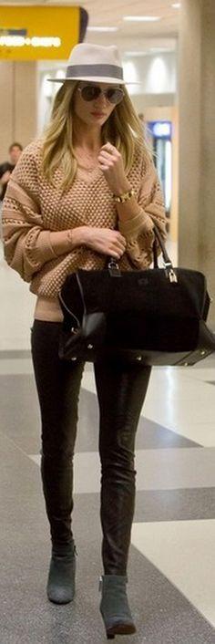 Who made  Rosie Huntington-Whiteleys black suede handbag, gold watch, tan hole sweater, aviator sunglasses, and black leather pants?