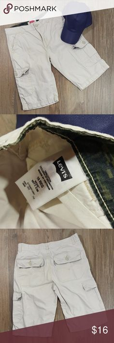 """Levi's cargo shorts Big boys 16 Condition: Great. Barely worn. After careful inspection, no signs of stains, tears or flaws.  100% cotton. Waist 28"""" Length 21"""" Images represent exactly how product looks like. Ships within 24 hours after purchasing. Feel free to check out the rest of my closet and bundle. Levi's Bottoms Shorts"""