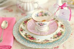 Pretty place setting with mismatched china.