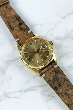 We love to add a fun strap to a classic and crisp Rolex oyster perpetual datejust watch. This taupe dial with 18K yellow gold case and fluted bezel pairs beautifully with this vintage hand-dyed leather strap. For more information, please contact us or visit our website. Cool Watches, Rolex Watches, Watches For Men, Vintage Rolex, Vintage Watches, Mens Fashion Suits, Mens Suits, Oyster Perpetual Datejust, Greece Travel
