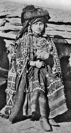 An Georgian woman in traditional festive/formal  outfit, 1897.