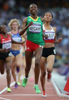 News Photo: Abeba Aregawi of Ethiopia crosses the line in…