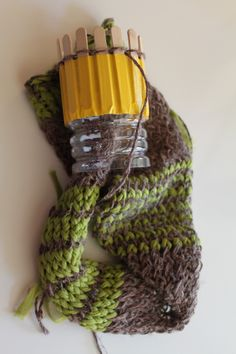 Loom Knitting Scarf made with a 15-short popsicle stick knitter (duct tape and a plastic water bottle).