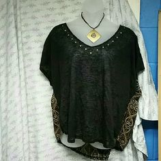 Nwt - Size 3 Hi &Lo Torrid Top Super cute top. Never worn. The necklace can be included  (Does have writing on the back haven't tried getting it off). Shirt just sits in my closet. No rips,stains,defects.  * All Sales Are Final *  * No Trades *  * No Holds* Torrid  Tops Blouses
