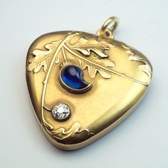 made in Moscow between 1899 and 1908 by a prominent jewelry firm of the period Feodor Lourie A triangular shaped antique gold locket with rounded corners i #JewelryVintage