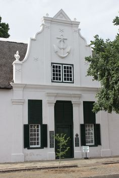 Urquhart House was built sometime between on land belonging to Johan Hendrik Greyling in the Cape Dutch style, with a prominent anchor and stars on the front gable. Incredibly, the reason for these decorations is unknown. The building became the … Spanish Architecture, Classic Architecture, Interior Architecture, South African Homes, Gable House, Cape Dutch, Dutch House, Dutch Colonial, Cottage