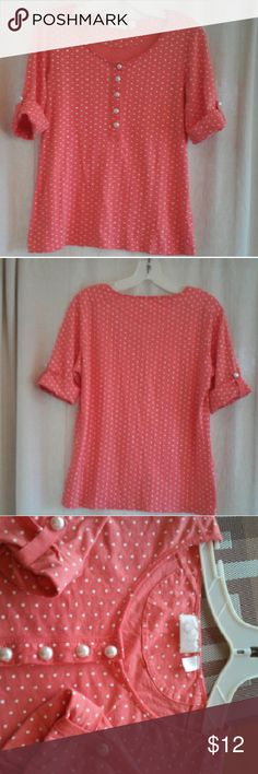 Chic women's blouse size large EUC Cute and stylish women's top made by Onque Sport New York in a size large. Color is peach or tangerine and has white polka dots and large white pearlized buttons on front and sleeves. Material is 60% cotton and 40% modal. Onque Sport New York  Tops