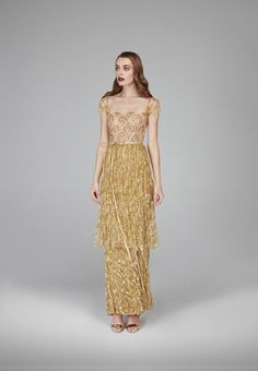 #Gatsby #decadence #flamboyance #over-the-top #indulgence #gown #luxury #layers #hand-sewn #golden #tassels #overlap #flapper #silhouette #skirt #anklelength #illusiontulle #embellished #lush #gold #materials #art-deco #pattern #glassbeads #silver #sequins #tear-drop #crystals #marquise #stones #sparkles #glitter #shimmering #glamorous #fashion #design #autumnwinter #2018 #eveningwear #hamdaalfahim