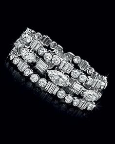 An Art Deco Diamond Bracelet, by Cartier                                                                                                                                                      More