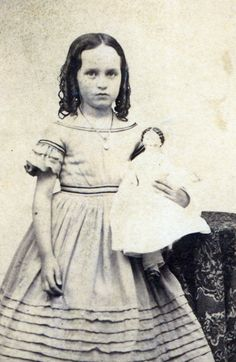 child and her doll rich fashions civil war girl with china head