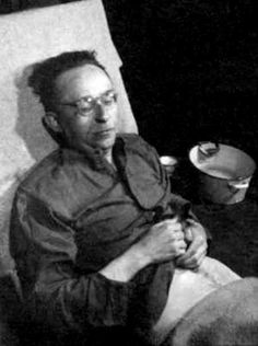 Himmler lies dead right after he committed suicide in British custody, May 23, 1945. He has been lifted off the floor and placed on a reclining hospital table.