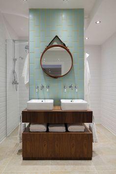 Sink on column with shower behind it, accent backsplash.