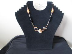 """$39.95. """"Whimsical Gold"""". Glass beads with sterling silver accents and Suzi tag. Pewter heart toggle clasp. 18""""L"""