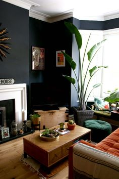 living room black wall fireplace moody bohemian interior home decor house decoration plants houseplants Dark Walls Living Room, New Living Room, My New Room, Living Room Furniture, Black Living Room Paint, Dark Green Living Room, Living Room Plants Decor, Living Room Decor Fireplace, Dark Rooms