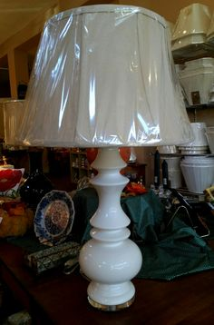 "The ""Remy"" lamp has a graceful silhouette perched atop a clear acrylic base. 31"" tall including the finial."