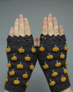 Dark Gray Gloves With Pumpkins, Hand Knitted Fingerless Gloves, Gloves & Mittens, Gray And Mustard, Knitting Accessories, Winter Accessories, Handmade Accessories, Halloween Knitting Patterns, Knitting Tutorials, Dark Grey Background, Grey Gloves, Fingerless Gloves Knitted, Wrist Warmers