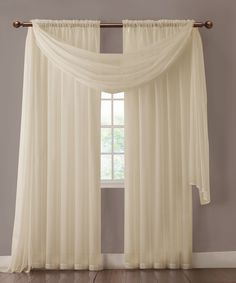 """Warm Home Designs extra wide Beige curtains have total width of 112 inches. 2 panels (1 pair) is included in a package. Rod pocket insert will fit most rods up to 2"""" in diameter Both scarf and curtain sheers are made from high-quality polyester and are designed to let most of the sun light through while offering some privacy at night."""