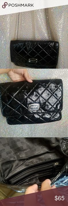 Micheal Kors Purse/Big Clutch AUTHENTIC Black Micheal Kors bag. waxy feel, Can be worn on shoulder with strap or tuck the strap away and hold as clutch. Pocket in the back and compartment on inside with zipper. Micheal Kors Bags Shoulder Bags