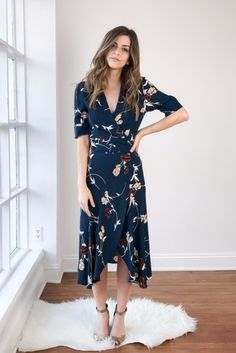 Dalton Crepe Dress by Ganni in Total Eclipse (navy) is a kimono-style wrap dress with a shall collar, piped sleeve detail, and a rounded hem. The cut to fits close to the body and runs true to size. Sizing: XS/34, S/36, M/38, L/40, XL/42 Brand origin: Copenhagen Fabric: 100% viscose Care: Machine wash cold delicate, lay flat to dry Measurements taken from size (S/36): 45 total length, 34.5 chest, 30 waist Model is 5'4 tall and wearing an XS/34