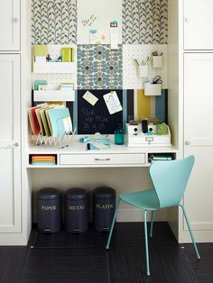Cool idea for a home office. I like the boxes and cans hanging in the wall to organize things.