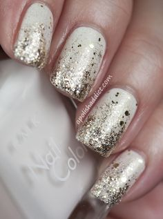 Gold flakie polish over white with faded gold glitter tips