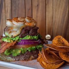 """""""It's only right that we end this long weekend that has been full of delicious BBQ dishes with this Surf N Turf Burger from @5280meat! Rachel grilled a burger made of @5280meat grassfed ground beef and layer it with guac, onions, tomato, smoked bacon, melted cheese and our @sizzlefishfit Shrimp that were seasoned with @flavorgod Cajun! Now THIS is how you do a surf n turf burger!  _______________________________"""