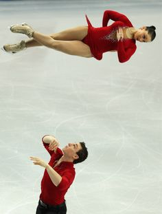 French pairs skaters Popova and Massot in the middle of their triple twist lift during the European Figure Skating Championships