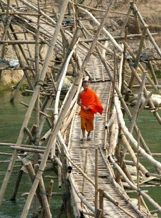 Monk on a bridge across the river, Luang Prabang