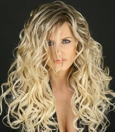Fascinating hairstyle with massive spiral curls for ultra long length hair.If your hair isn't long enough,you can get this alluring look with hair extensions.