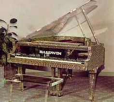 Liberace's mirrored Grand Pianos by Baldwin. (Liberace only played on Baldwin pianos). Gorgeous!  I think Dino Kartsonakis has one of Liberace's pianos.  What a treasure.  If only the incredible talent could have been passed on!