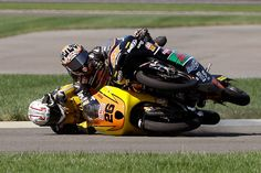 Adrian Martin (26), of Spain, and Niklas Ajo, of Finland, crash on the opening lap of the Moto3 motorcycle race