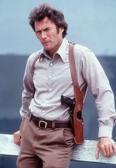 """lastfamous: """" Clint Eastwood. On the set of Magnum Force. San Francisco, 1972. Photo by Julian Wasser. """""""