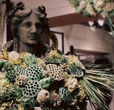 Seafoam Display with weathered lotus pods, wild grass, chico chokes, and preserved hydrangeas-  Knud Nielsen showroom Atlanta